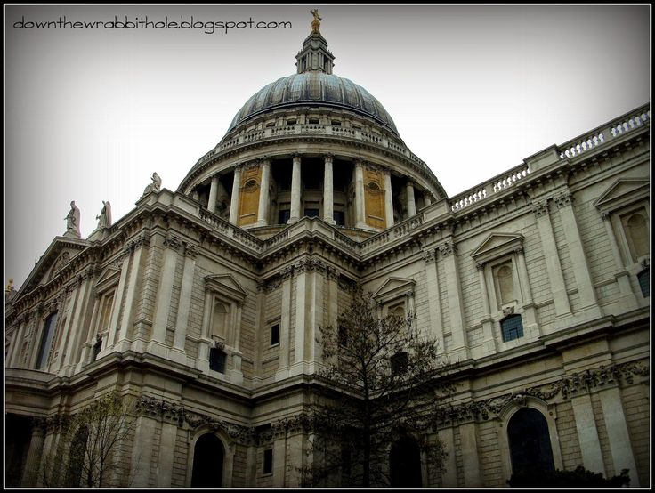 """St. Paul's Cathedral, towering into the London sky. Find out more at """"Down the Wrabbit Hole - The Travel Bucket List"""". Click the image for the blog post."""