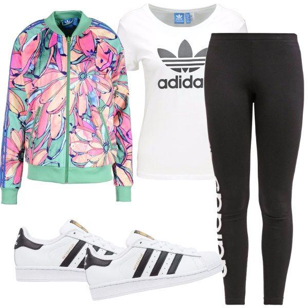 Outfit per la palestra, per la scuola e per il tuo tempo libero, scopriamolo insieme: t-shirt con stampa, leggings neri, sneakers, giacca colorata in fantasia e sei pronta per tenere il ritmo.
