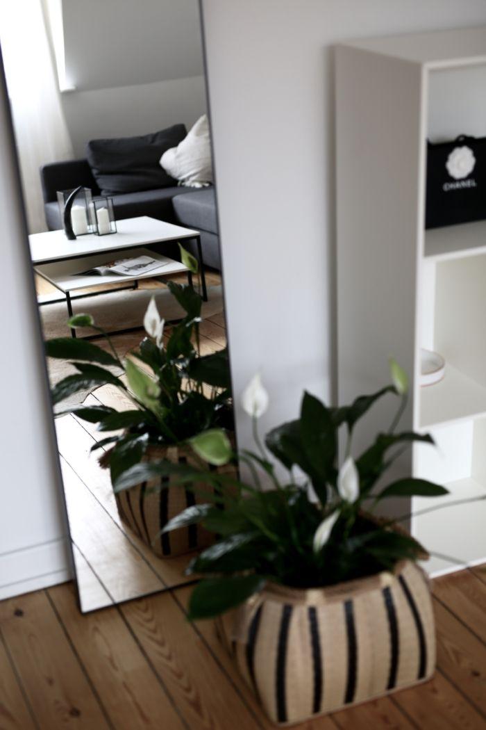 Home Stories - Einrichtung mit Korbdetails und Blumen