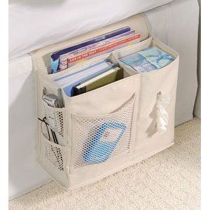 Bedside Caddy. Tucks neatly in under the mattress...I've been thinking of putting one together for the side of the couch