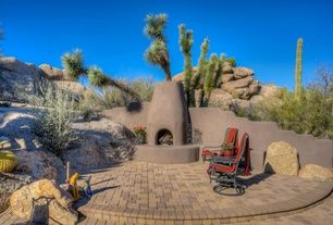 Southwestern Patio with exterior brick floors, outdoor pizza oven, Fence