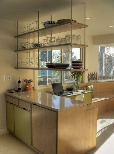 I quite like demolishing uppers that ruin lines of sight and close in a room, but storage can suffer for it. In a kitchen renovation that is modern industrial, here is a steal-able DIY open shelving solution that could be done with plumbing fixtures securely hanging wood and/or glass from the ceiling while maintaining an open feel.