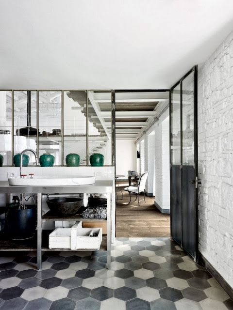 {Interior} Old factory converted to industrial home in Spello by Paola Navone | Rue du chat qui peche | kitchen | hexagonal floor tiles
