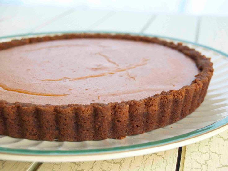 Claire's 5-Ingredient Ginger-Pumpkin Tart : To keep her ingredient list at or below five, Claire uses sweetened condensed milk to thicken her filling. Pour it into a ginger cookie crust.