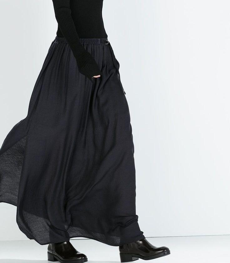 Lång kjol med boots. Svarta leggings under? Skulle lätt kunna sy.