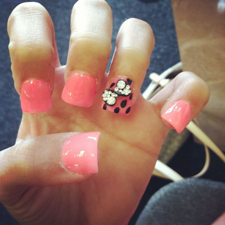 Pink acrylic flare nails with black rhinestone bow with ...