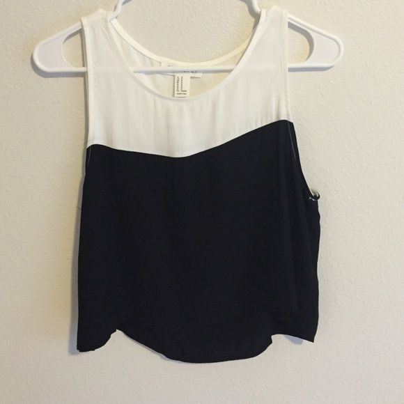 Black and White Shirt New with Tags. Black and White Shirt. 100% Rayon. Forever 21 Tops Crop Tops