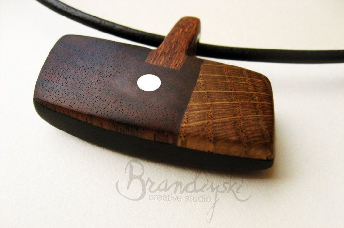 WOODEN JEWELRY - Original Handmade Wooden Necklace - black ebony, rose wood, oak, mahagony & aluminium elements, 3mm leather cord. €55,00, via Etsy.