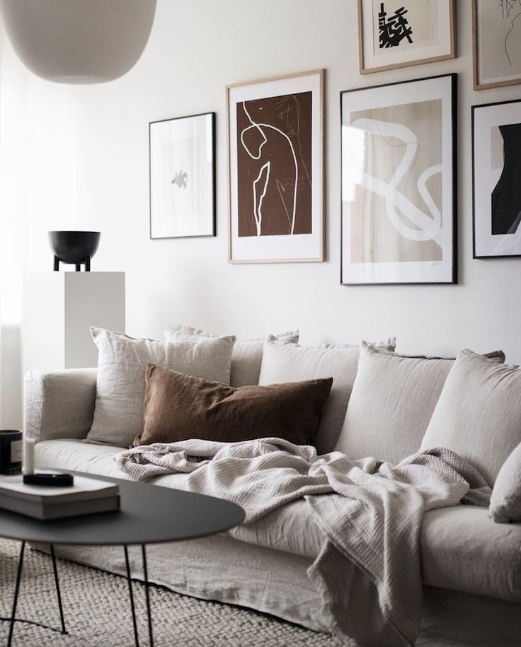 Swedish living room in soothing neutrals with line…