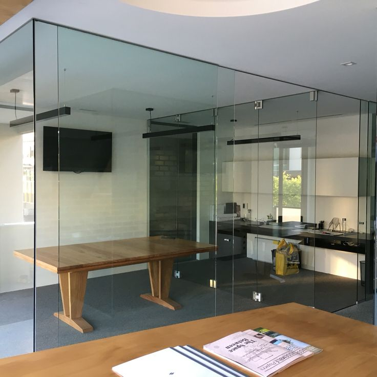 Internal office fit out with frameless glass sliding and bifold doors.