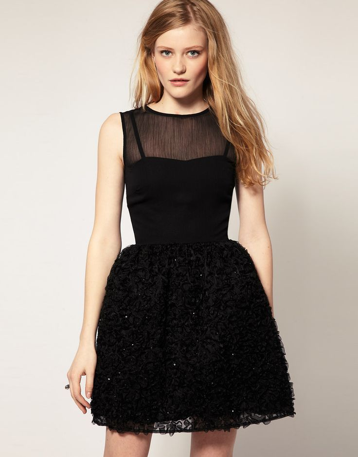 Love this mini dress with flared sequin ribbon skirt.