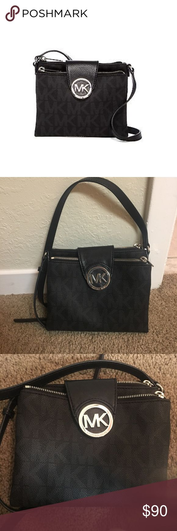 Michael Kors Fulton large crossbody black bag Black leather with the Michael Kors emblem all over. This has been used very rarely and is in excellent condition. There are no snags, scratches, stains, or anything on and inside this bag. It's great for an everyday use! The strap is adjustable. Michael Kors Bags Crossbody Bags