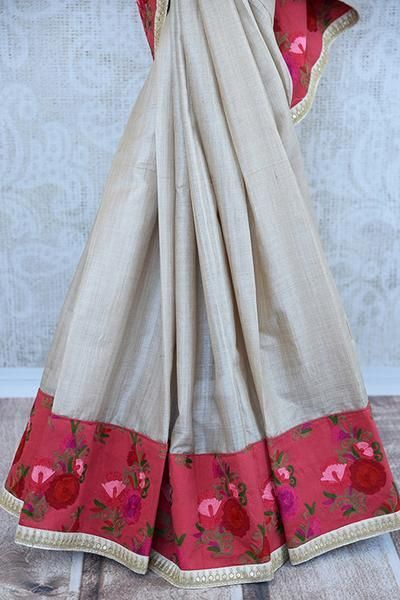 Classic beige tussar with beautiful floral embroidery saree. Perfect silk saree for Indian parties and get a classy look.- embroidered border