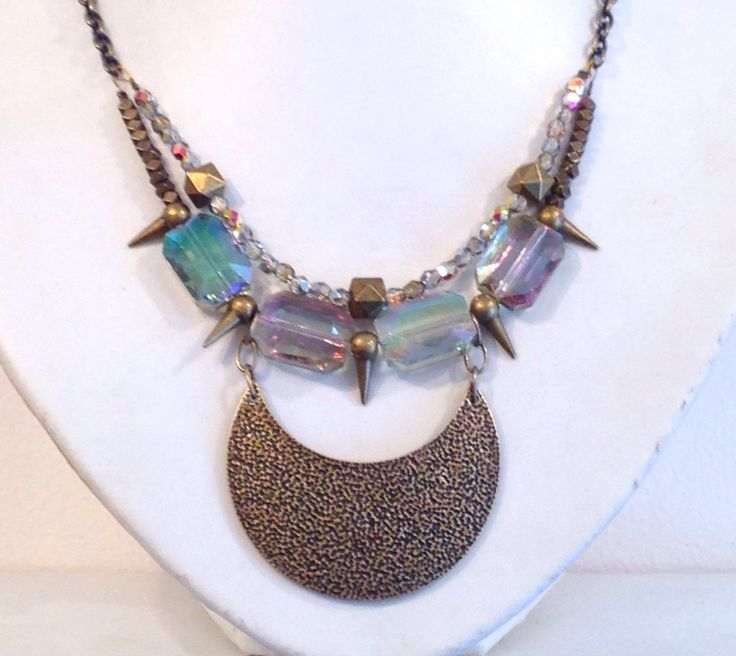 Statement necklace with antiqued brass spikes, chain and crescent pendant and large aurora borealis crystals by cheriebeadle on Etsy https://www.etsy.com/listing/223192722/statement-necklace-with-antiqued-brass