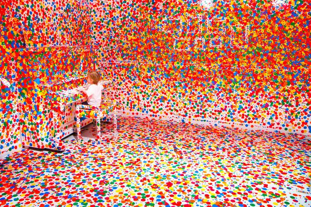 Yayoi Kusama's legendary installation, Obliteration Room, where thousands of children were given stickers and unbridled freedom in a stark white room.