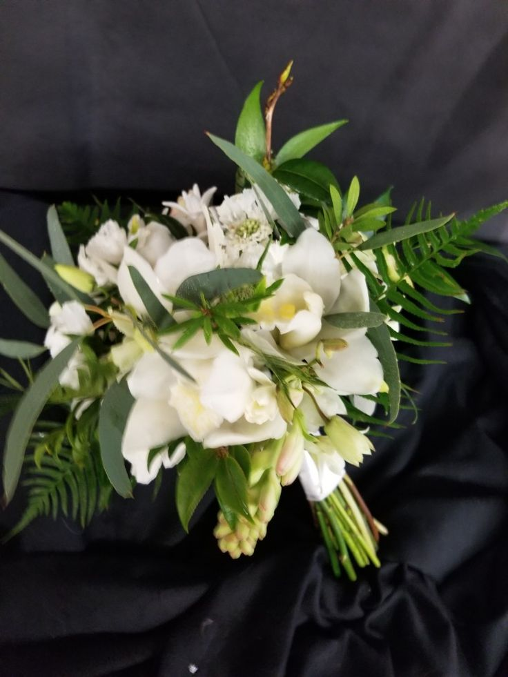white and green bridal bouquet #graceflowershawaii #hawaii #hawaiiflowers #hawaiiflorist #bigisland #bigislandflowers #bigislandflorist #tuberose #roses #orchids #scabiosa