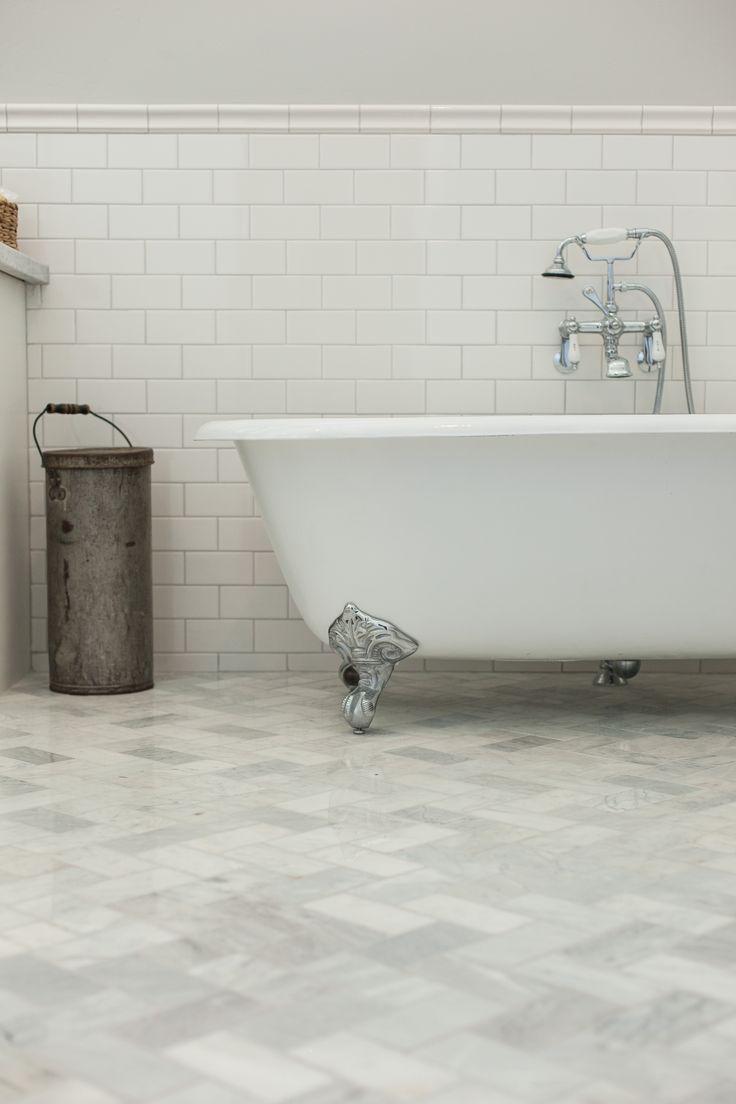 Clawfoot tub on carrara marble subway tile laid on - Carrara marble floor tile bathroom ...