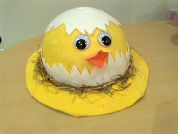This Easter bonnet is effective, yet deceptively easy to make. Paper mache hat, covered in a yellow duster, with some simple chick decoration.