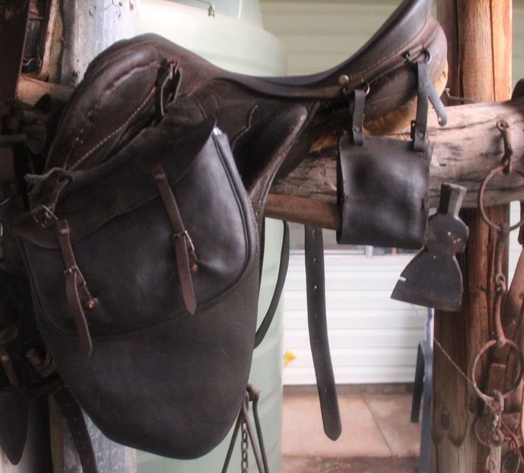 Australian stock saddle. has carry strap for small tomahawk. The other bag is to put anything in and not for a specific item