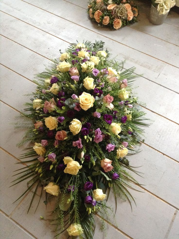 cream and purple funeral flowers, coffin spray, casket