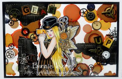 Bonnie's MM page using alcohol inks on Yupo paper...image is Holly Durr's All Aboard from Sweet Pea Stamps