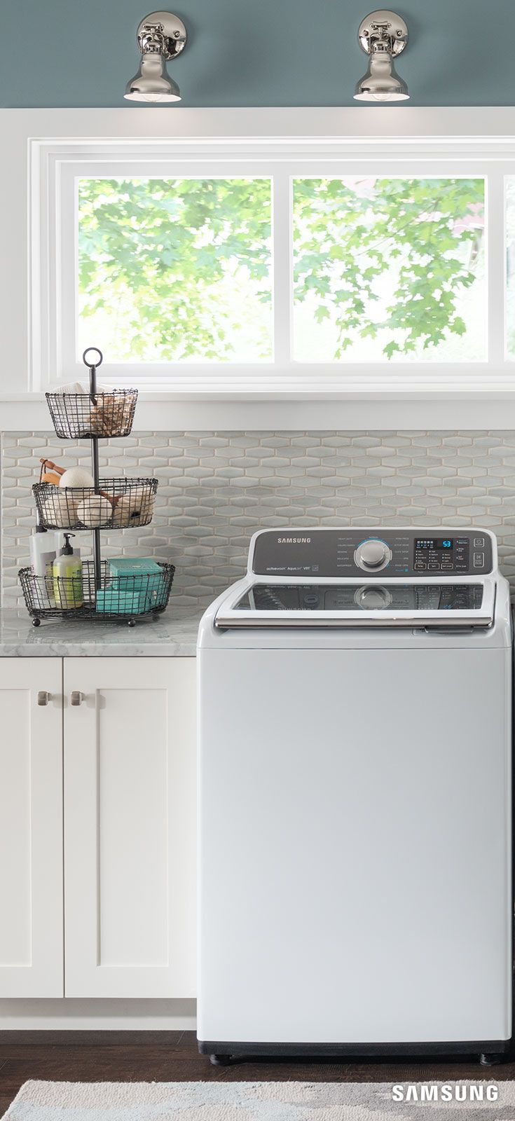 Samsung's white Top Load Washer with activewash adds an airy brightness to your laundry room while handling heavy loads faster and more quietly. Highlight the sleek look of your washer by pairing it with varying textures, like wooden cabinetry or a stone backsplash.