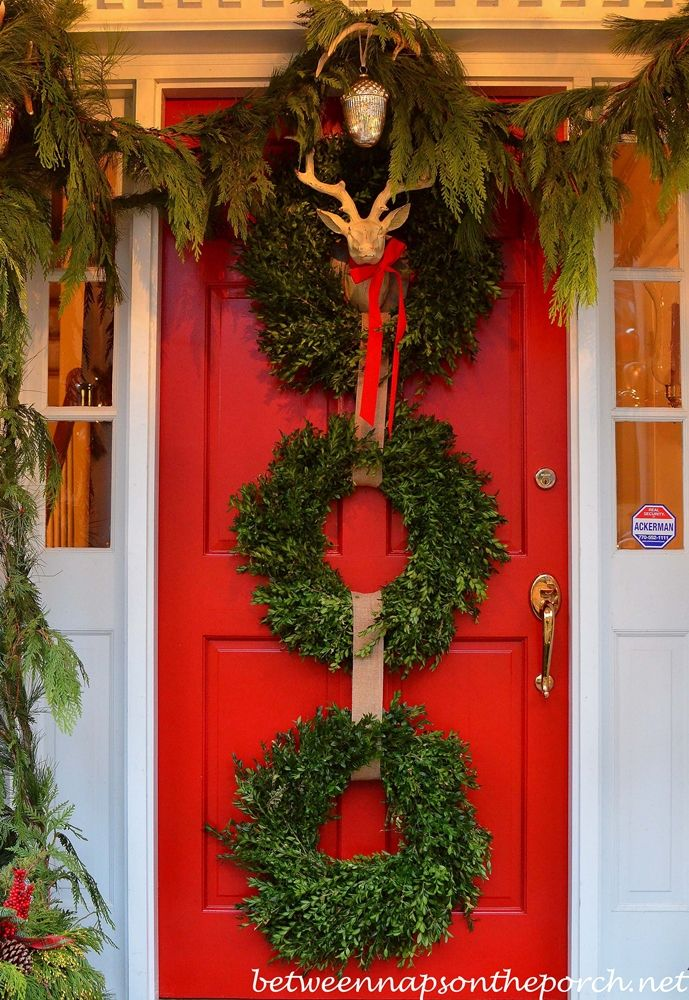 Red Front Door with Three Christmas Wreaths from Between Naps on the Porch.