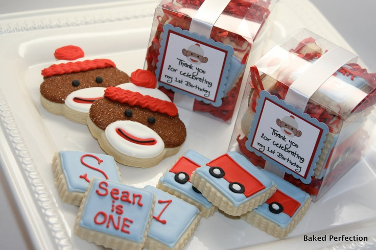 Baked Perfection: Sock Monkey Cookies in a Box//Hand Decorated Sugar Cookies in a box include sock monkey, wagon, and monograms//birthday favors