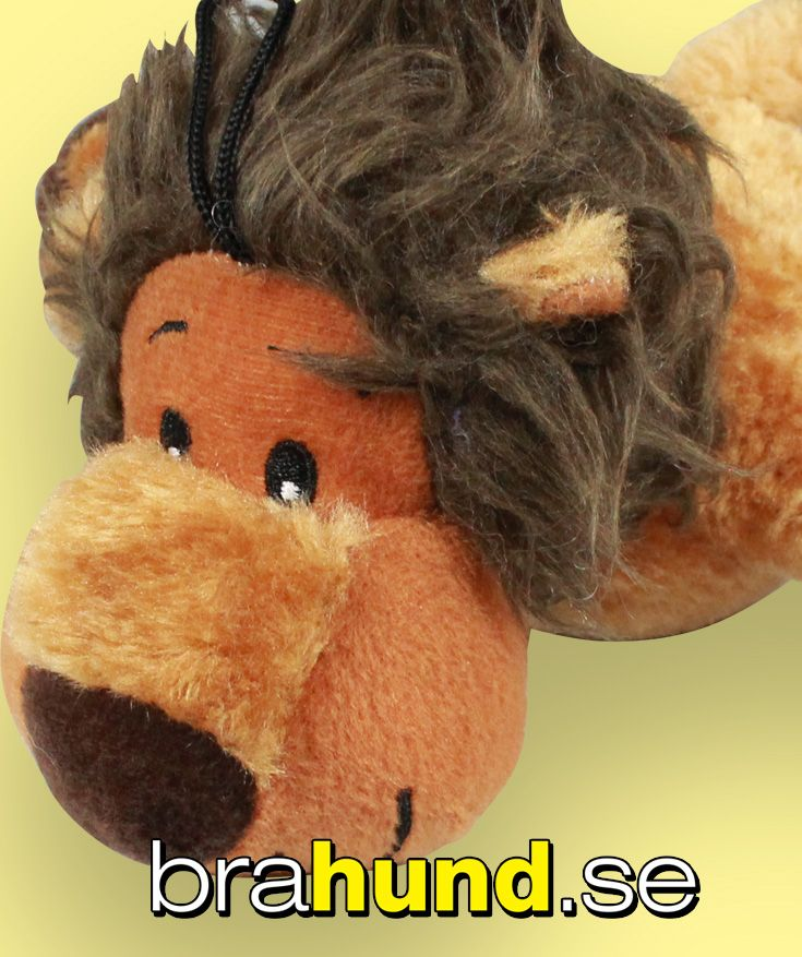 Plysch lejon som piper när hunden biter i den, med upphängning, ljusbrun, 20 cm.