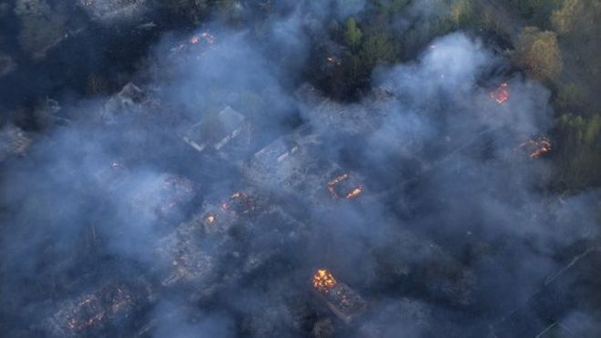 Fire hits an abandoned village in the exclusion zone around Chernobyl, Ukraine, Tuesday, April 28, 2015,