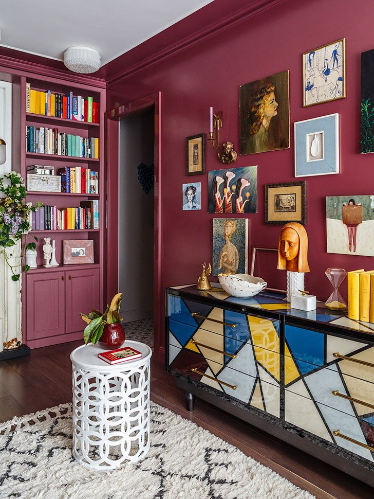 Designer's home (see more) #moscow #russia #apartment #small #tiny #red #wall #decor #home #phrames #pictures #decor #dresser #rug #colors #colorful #scheme #books