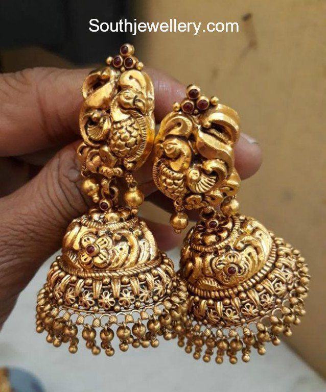 22 carat gold antique finish peacock jhumkas by Premraj Shantilal Jewellers. gold jhumki designs, latest gold jhumka models, peacock buttalu models