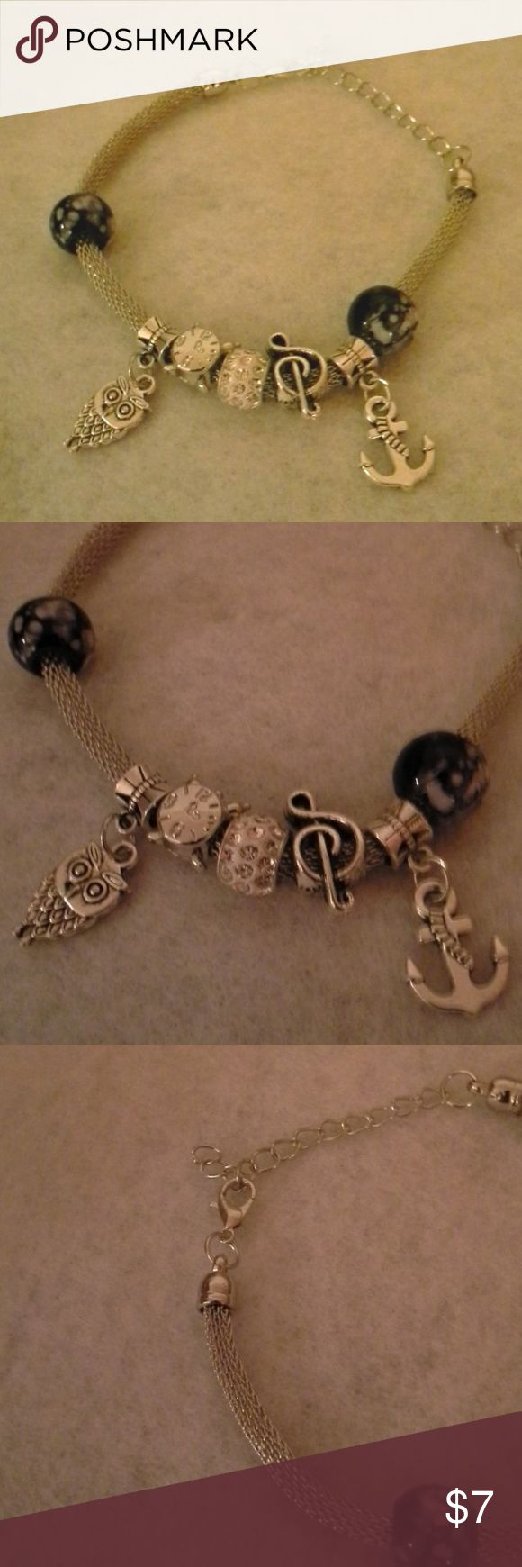 Charm bracelet Cute and whimsical charm bracelet with two black and white patterned circles featuring pretty charms of an owl, musical note, anchor, and alarm clock; lightweight feel; lobster clasp with adjustable chain; too cute to miss; great condition Jewelry Bracelets