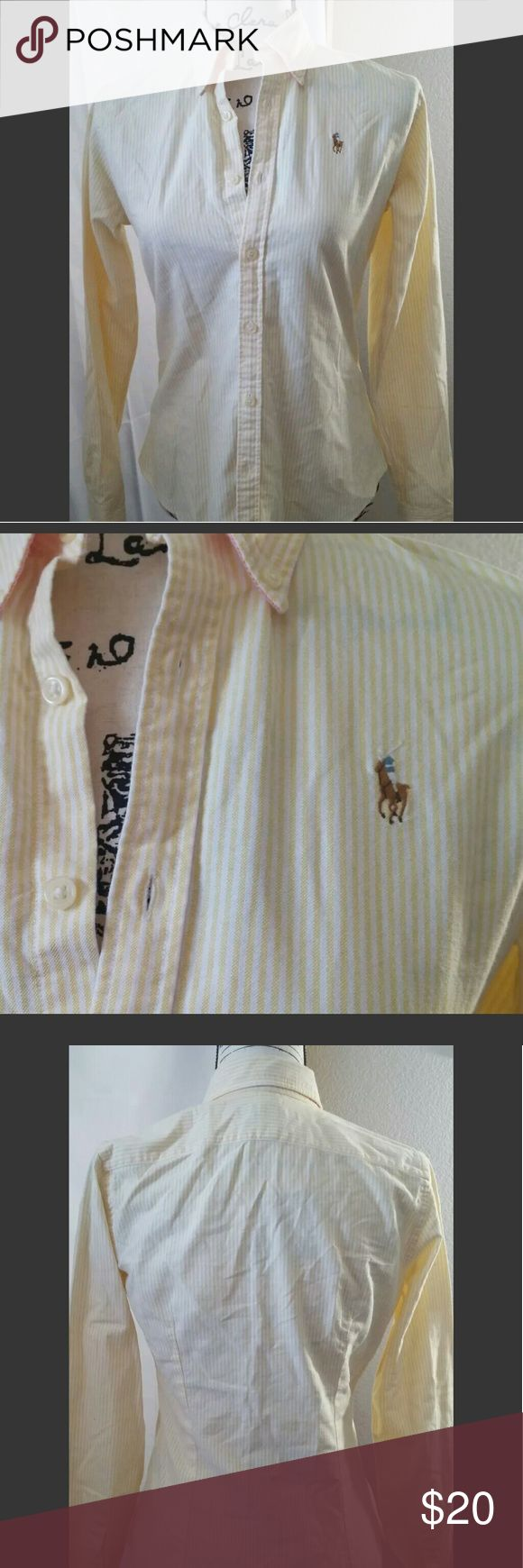 "Sz 4 Ralph Lauren slim fit yellow dress shirt Ralph Lauren slim fit yellow/white striped long sleeve button-down collared dress shirt. 100% cotton. Polo logo on left breast.   Size 4 - 25"" long, 18"" pit to pit, 29"" waist.  274/clo2 Ralph Lauren Tops Button Down Shirts"