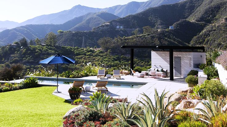 Real Estate Envy: 7 Dreamy Vacation Homes // pool, outdoor umbrella, patio, lounge chaises, mountains