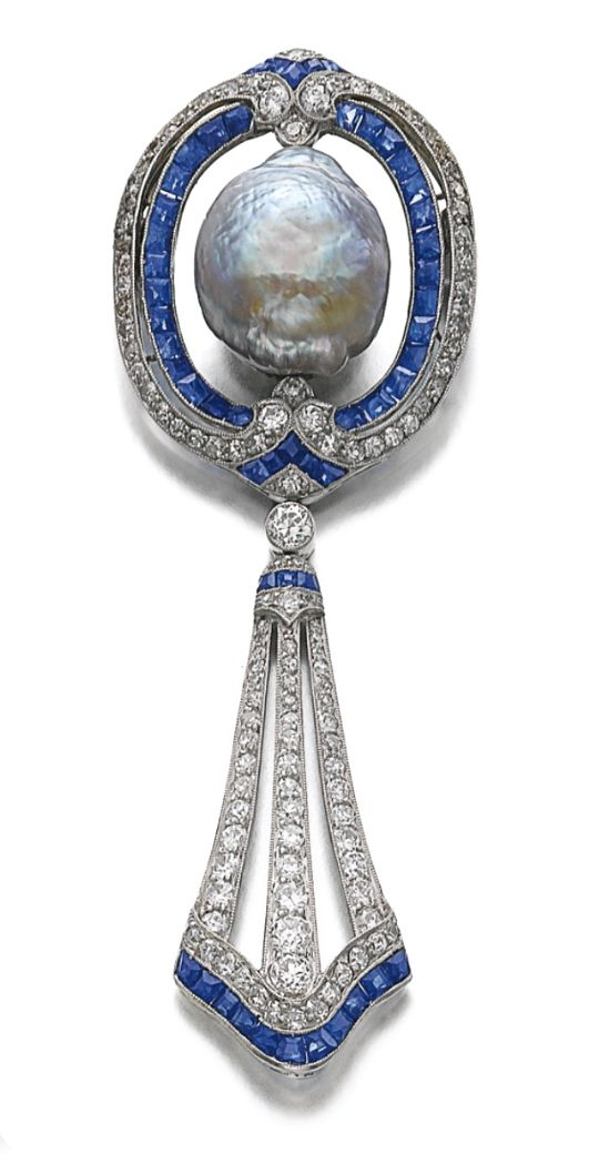 SAPPHIRE, DIAMOND AND CULTURED PEARL BROOCH, CIRCA 1910 WITH LATER MODIFICATION. The brooch centring on a baroque cultured pearl of iridescent aubergine tint, encircled within lines of millegrain-set circular- and single-cut diamonds, and calibré-cut sapphires, to a similarly set pendant of ribbon design