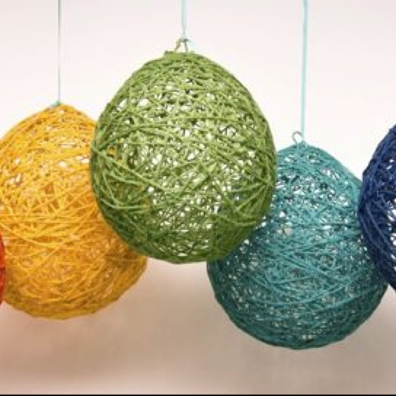 Yarn, glue, balloons. All you need to craft giant ornaments for decorating—great for toddlers and preschoolers!