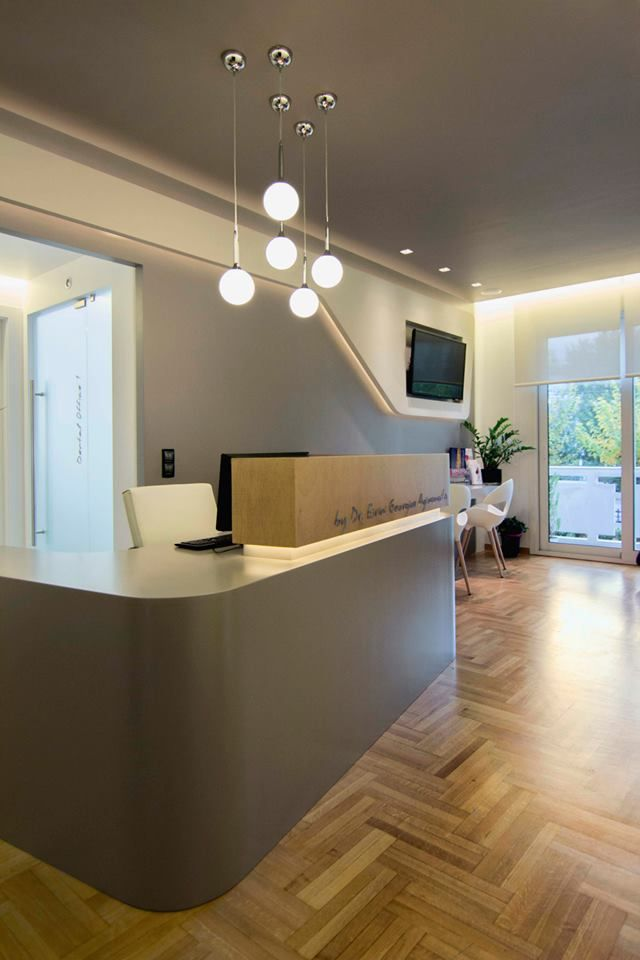 Dental Clinic in Athens by architect Ioanna Polymenea... Nice front desk  area