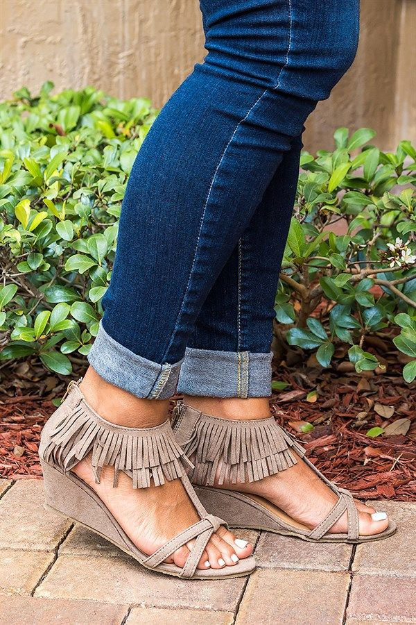 Adorable T-strap sandal featuring a back zipper fringe design, and a wrapped wedge heel.