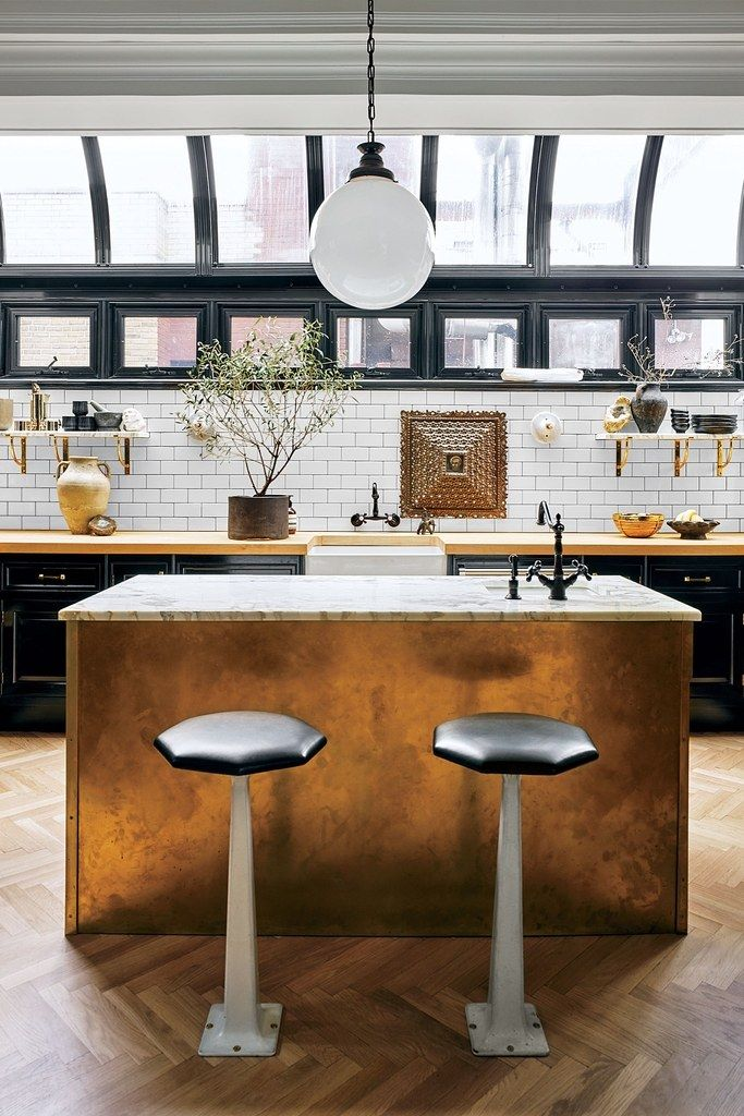 Lovely Elegant Industrial Kitchen With A Bronze Island Home Design Ideas