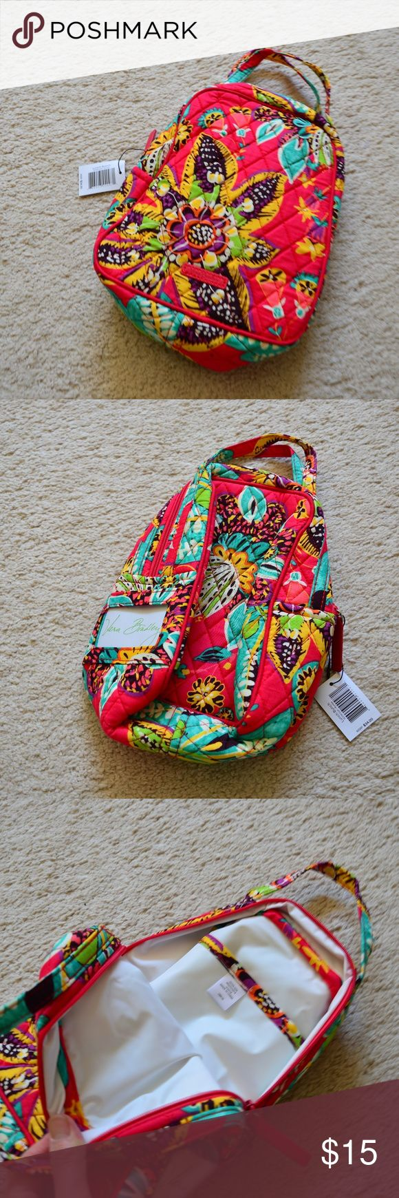 """Vera Bradley Lunch Bunch Bag in Rumba Vera Bradley Lunch Bunch Bag in Rumba  New With Tag. Comes From Pet Free, Smoke Free Home.  Holds most pre-packaged frozen meals or Thermos(R). Interior features a slip pocket. External ID window. Zip closure.  Dimensions 7 ½"""" w x 9"""" h x 4 ¼"""" d with 3"""" handle drop  Stock pictures only. Accessories"""