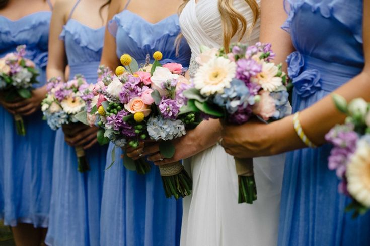 periwinkle bridesmaid dresses, colorful bouquets  // photo by Paul Francis Photography