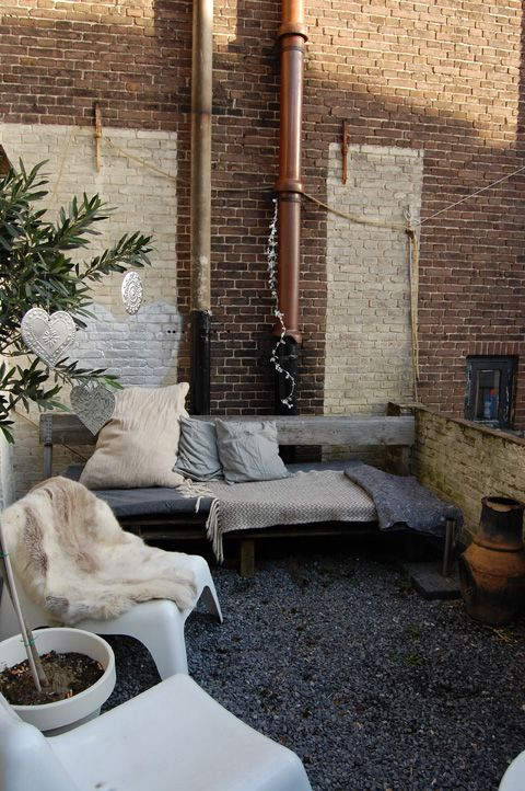 Rustic industrial styled terrace space - love the blend of fur, gravel, exposed brick, unfinished timber and copper...
