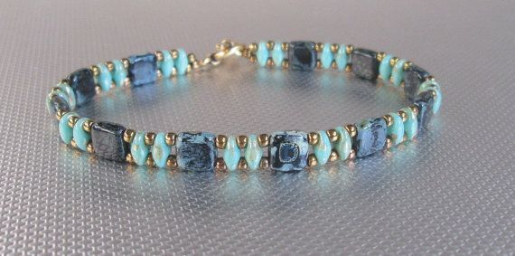 A beautiiful jet picasso and teal super duo and tila bracelet that is unique. You wont see this bracelet anywhere else. This tila bead is beautiful