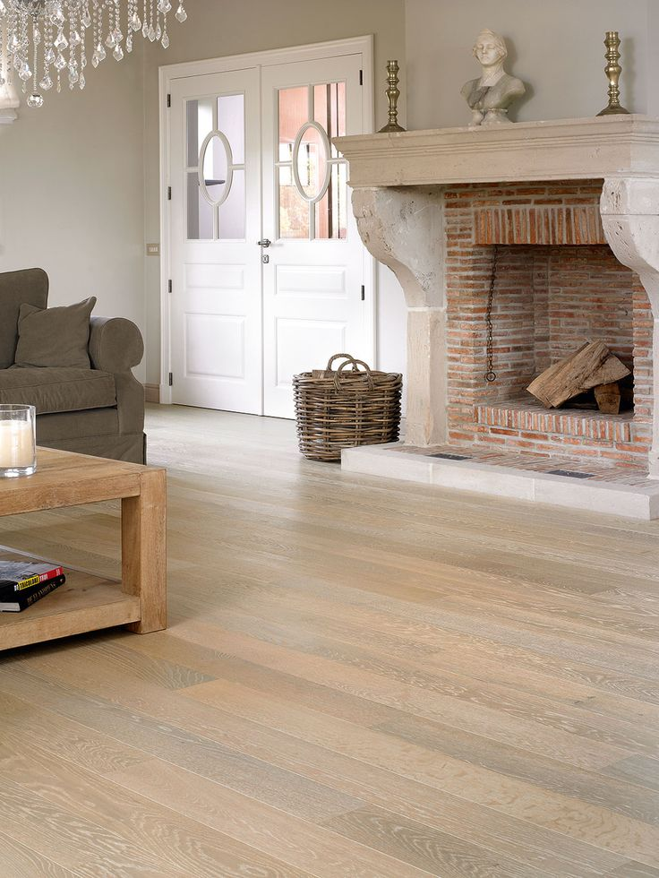 Quick-Step Parquet Flooring - Castello 'Whitewashed oak matt, planks' (CAS1353) in a country living room. To find more living room inspiration, visit our website: https://www.quick-step.co.uk/en-gb/room-types/choose-the-perfect-living-room-flooring #salon #woonkamer