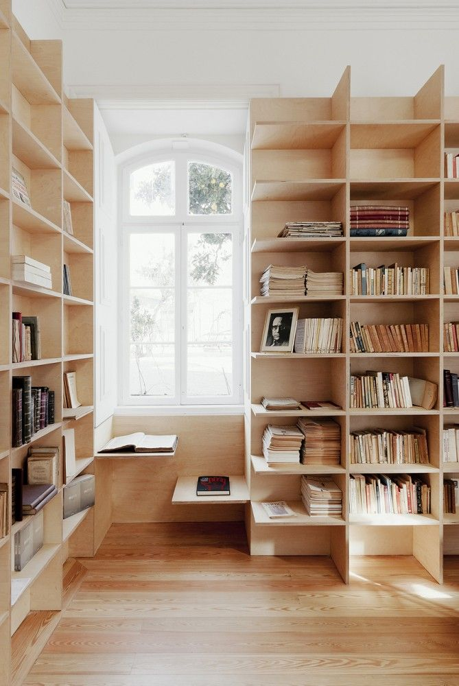 A study nook by the window that is integrated with the shelves. I totally need this