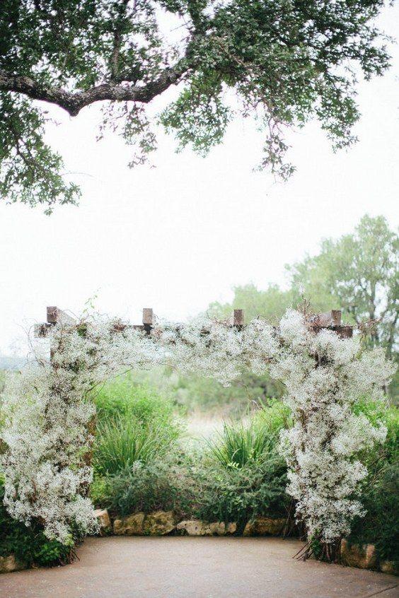 rustic baby's breath wedding arch / http://www.himisspuff.com/rustic-babys-breath-wedding-ideas/6/
