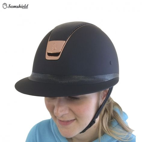 Samshield Miss Shield Navy Shimmer Riding Hat with Rose Gold Trim - £435. We're proud to introduce the stunning new Miss Shield riding hat from Samshield. Specifically designed for a classic women's style, the hat features a longer visor and frontal band for an elegant feminine finish.