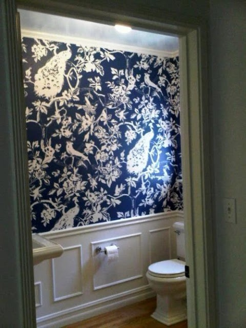 """Chinoiserie Chic"". Dark blue peacock wallpaper in toilet. Very fancy."