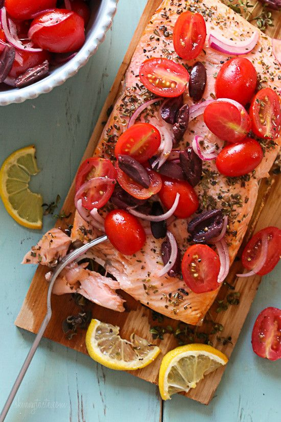 Grilled wild cedar plank salmon with fresh herbs topped with tomatoes, kalamata olives and red onion. This is so flavorful, and simple to make, perfect for weeknight cooking or fancy enough to serve if you're having guests. Aside from soaking the plank in water, the rest takes under 30 minutes to make.